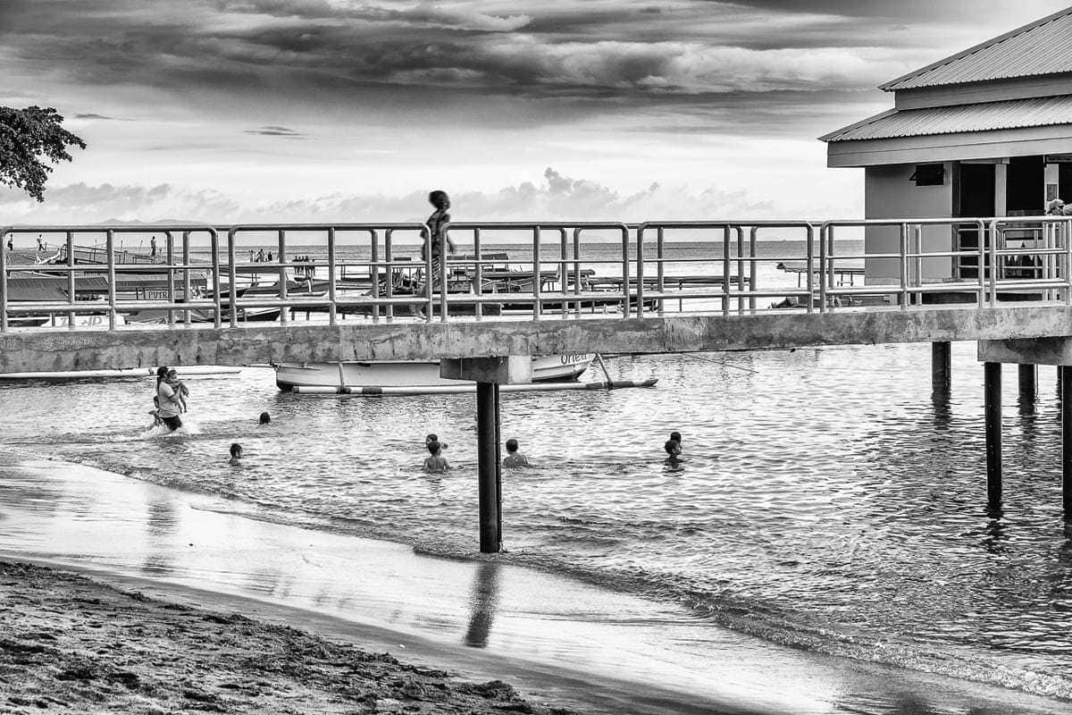 Swimming running Senggigi Pier Lombok Island Indonesia