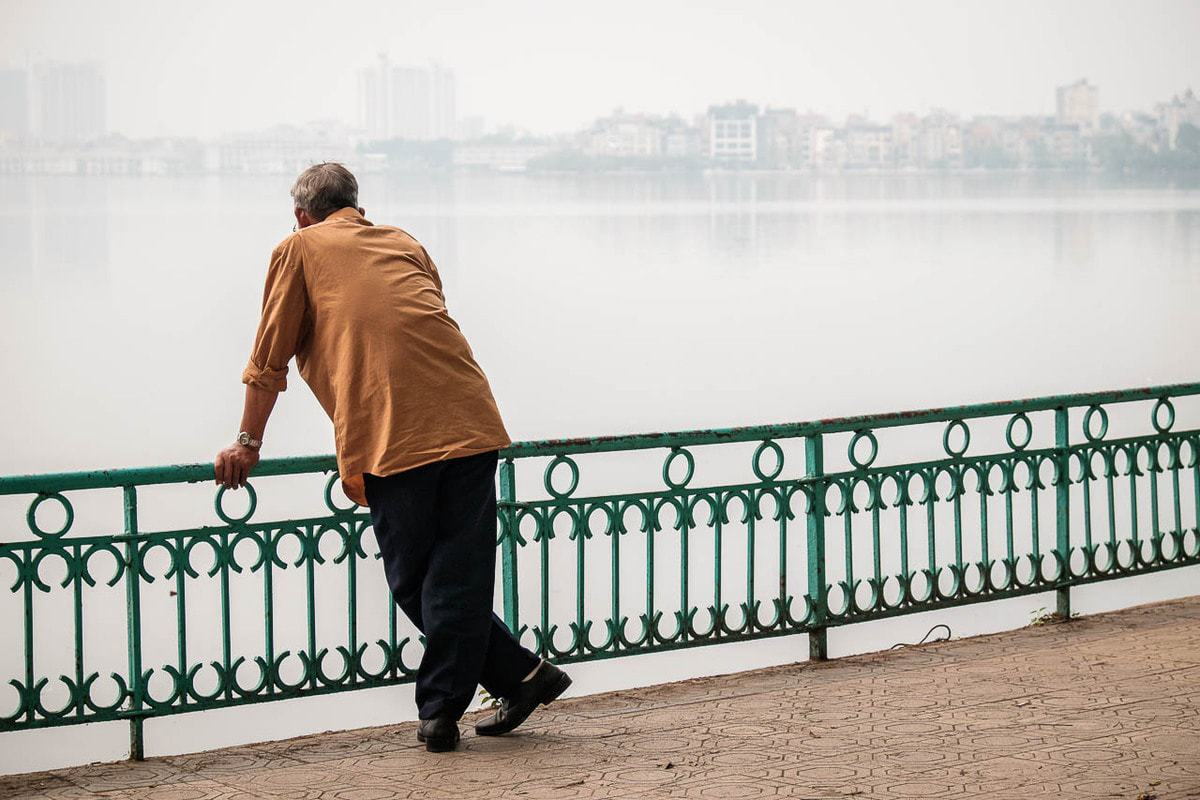 Vietnamese man looks Ho Tay West Lake Hanoi Vietnam