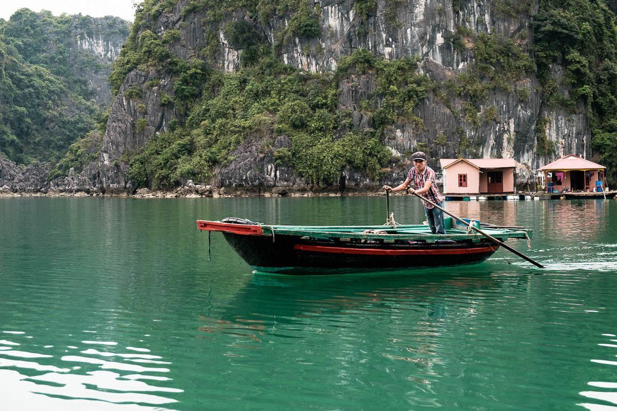 Vietnamese fisherman at the floating village in Halong Bay, Vietnam.