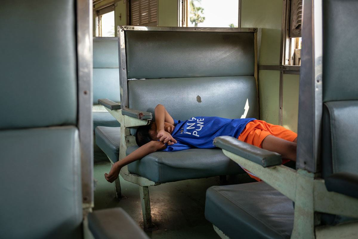 Napping on the Bangkok - Kanchanaburi train, Thailand.