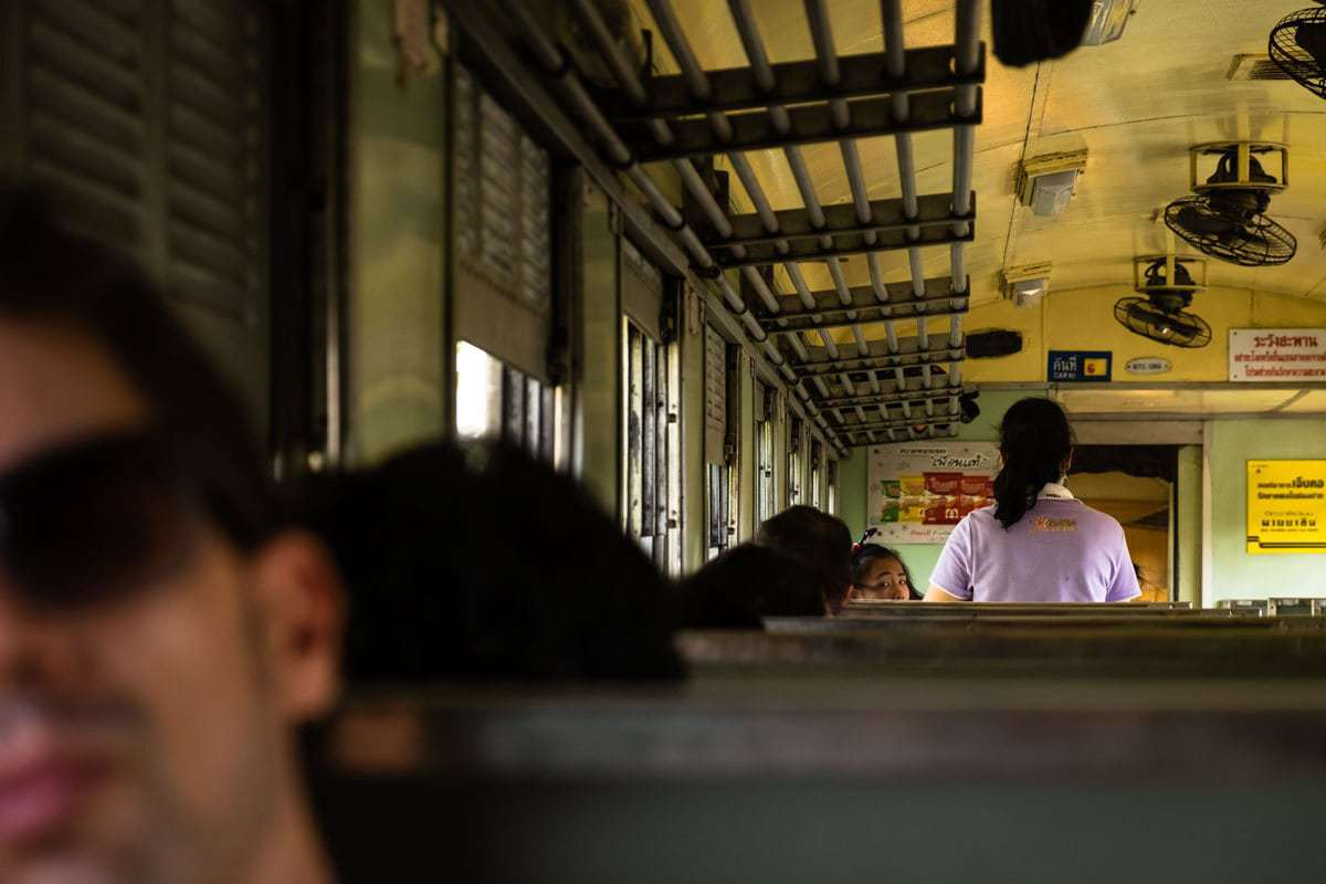 Passengers on the Bangkok - Kanchanaburi train, Thailand.