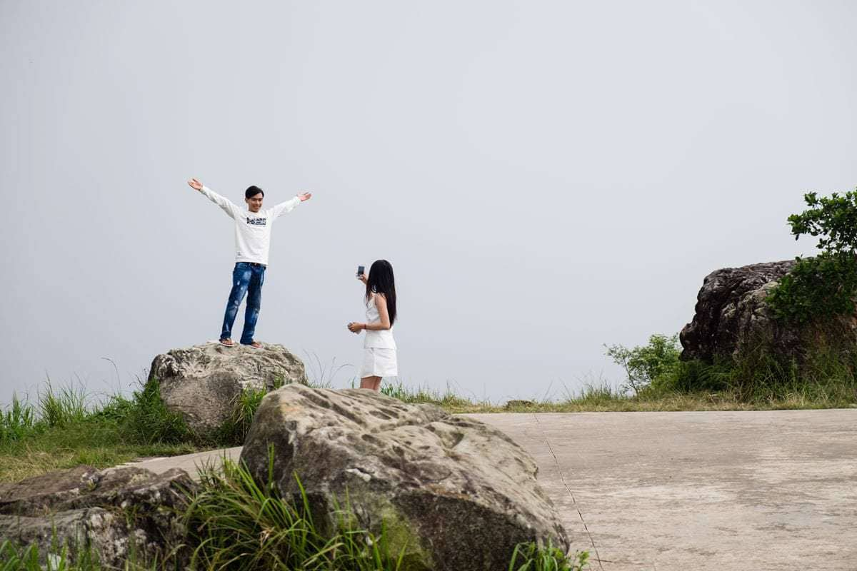 Young Khmer couple enjoys the foggy day at Bokor Mountain. Kampot, Cambodia.