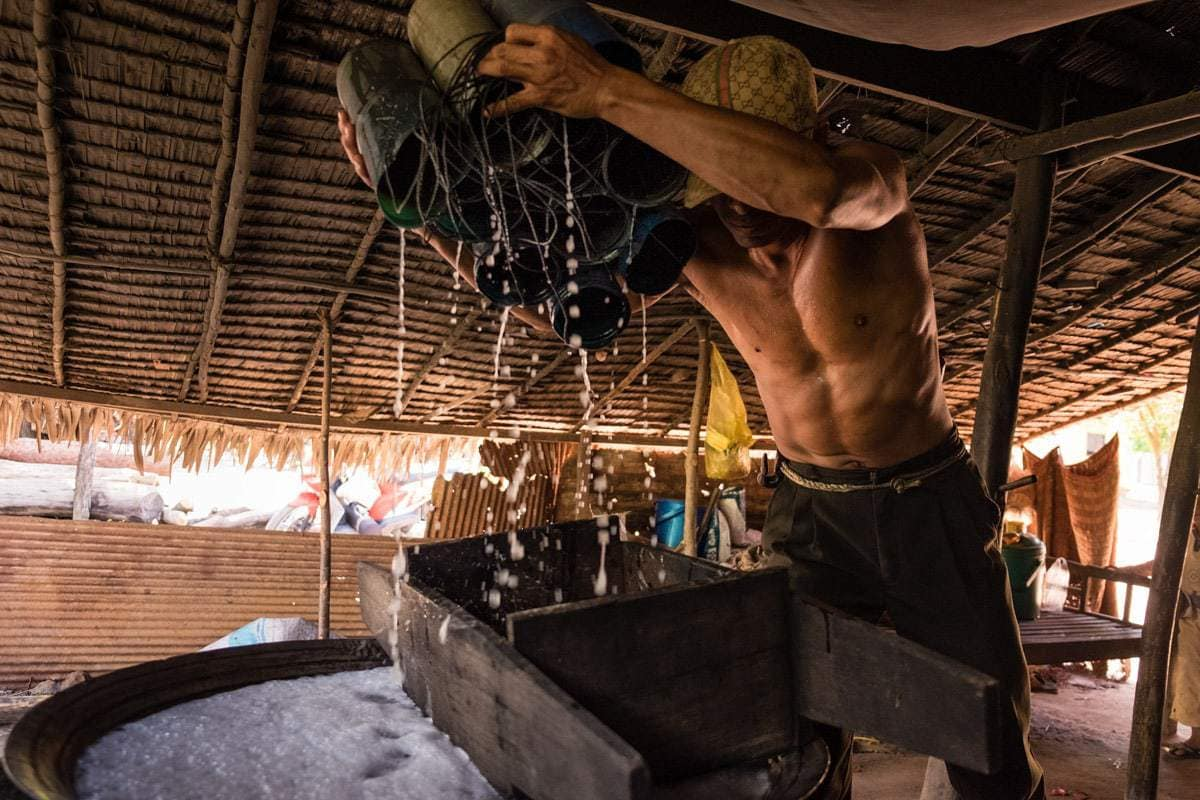 He makes sure the containers are completely emptied.