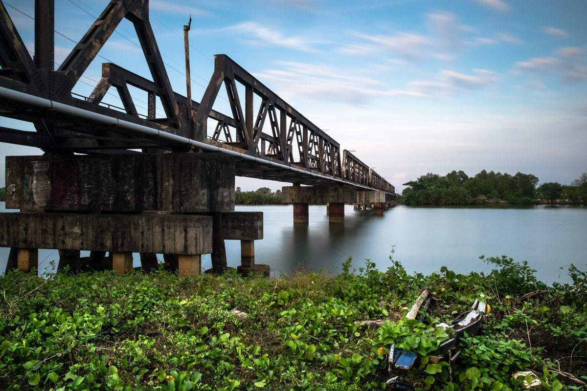 Steel railway bridge over the Kampot River.⠀ Kampot, Cambodia.