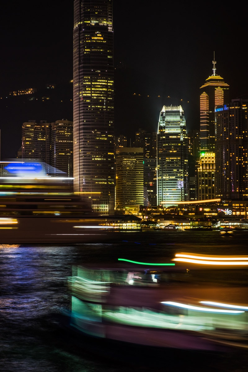 Boats come and go at Victoria Harbour by night. Hong Kong Island, Hong Kong.