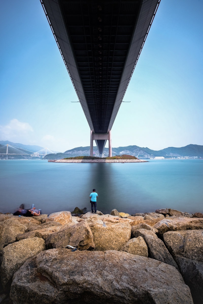 Fishing under the Tsing Ma Bridge. Ma Wan Island, Hong Kong.