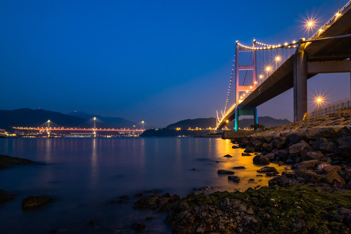 Tsing Ma Bridge by night. Ma Wan Island, Hong Kong.