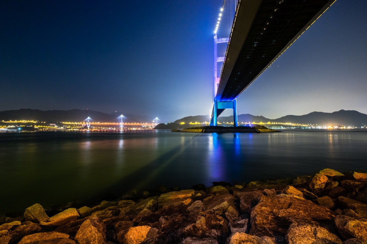 Under the Tsing Ma Bridge by night. Ma Wan Island, Hong Kong.