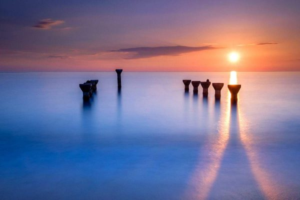 Long exposure photo remains pier sunset Lido Paola Cosenza Italy. Landscape seascape waterscape cityscape photos Southeast Asia