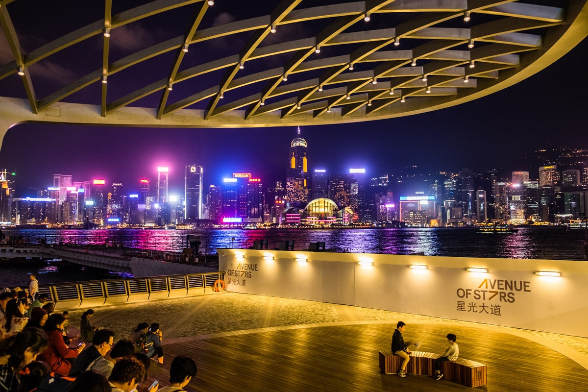 The Avenue of Stars by night. Victoria Harbour waterfront in Tsim Sha Tsui, Hong Kong.