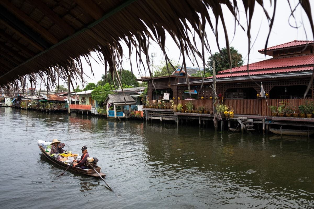 Thai snack vendors on a boat approach the banks of Bang Luang Canal.