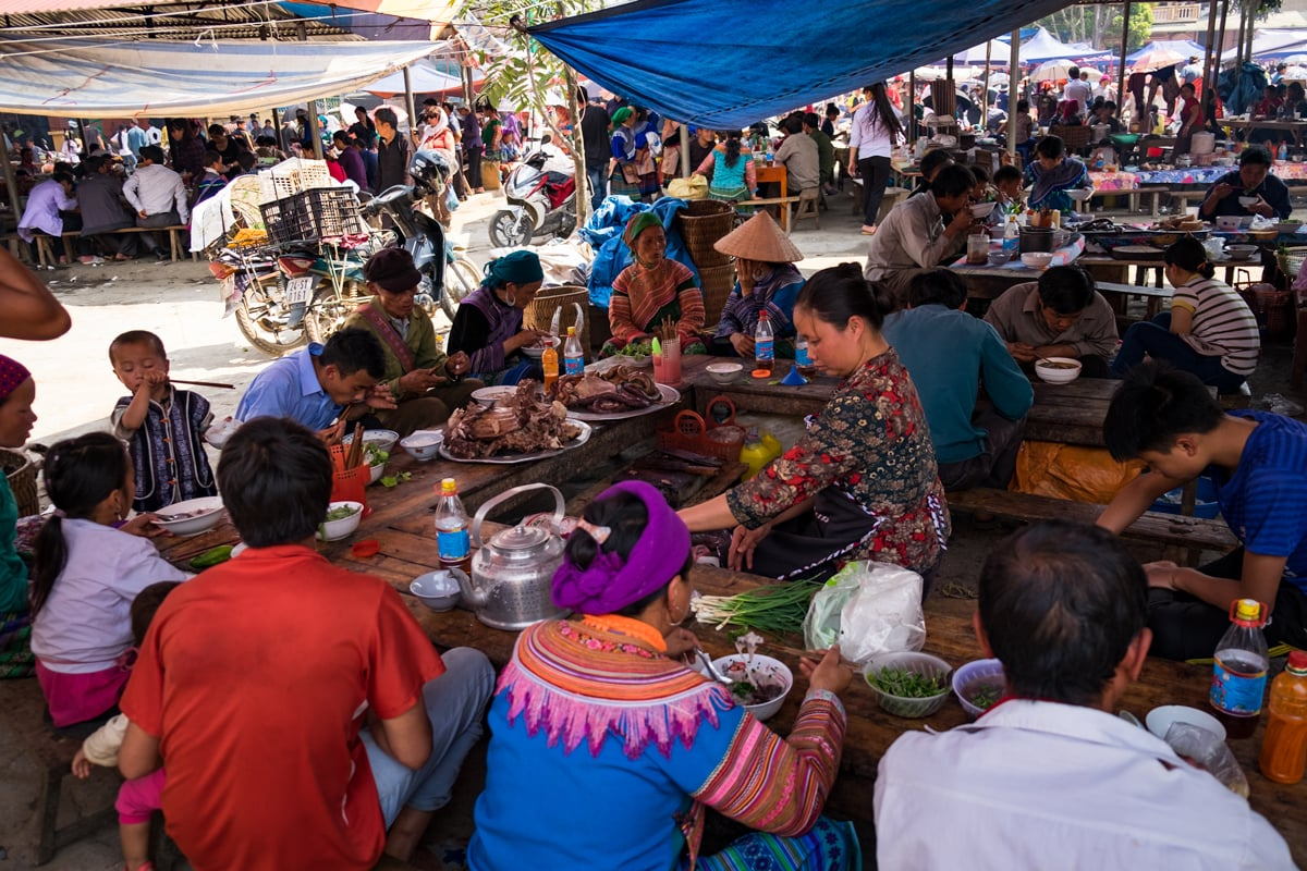 H'Mong people eat at Bac Ha Market.