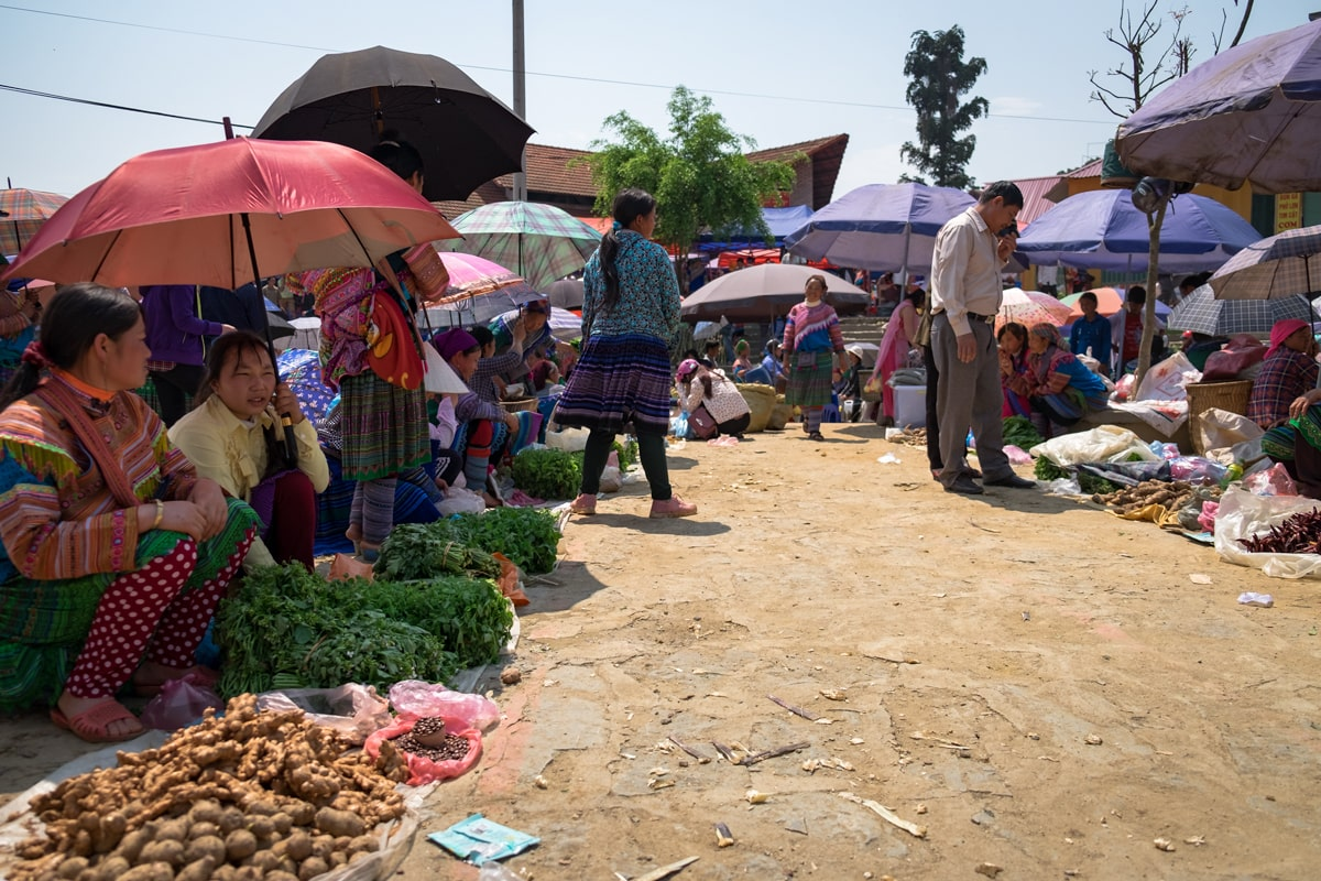 Vietnamese H'Mong women sell fruits and vegetables at Bac Ha Market in Northern Vietnam.