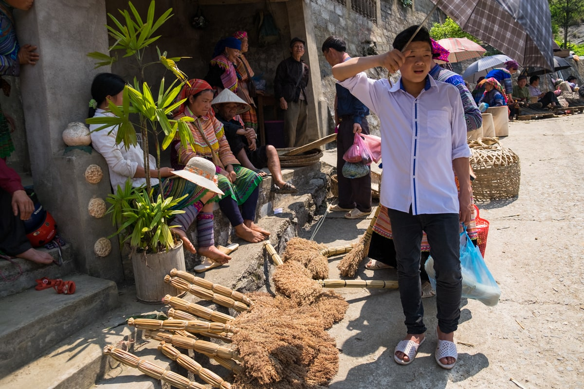 Hill tribe Flower H'Mong people sell brooms at Bac Ha market, Vietnam.