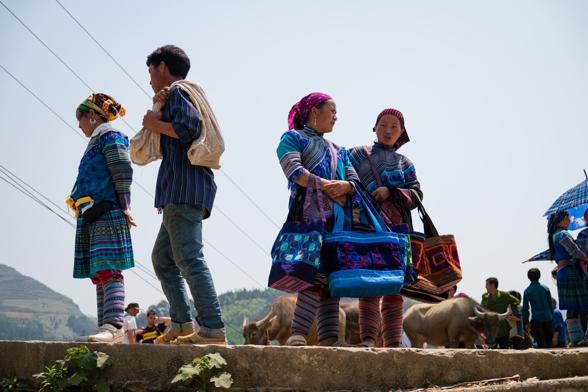 Hill tribe Flower H'Mong people sell handmade bags at the buffalo Bac Ha market, Vietnam.