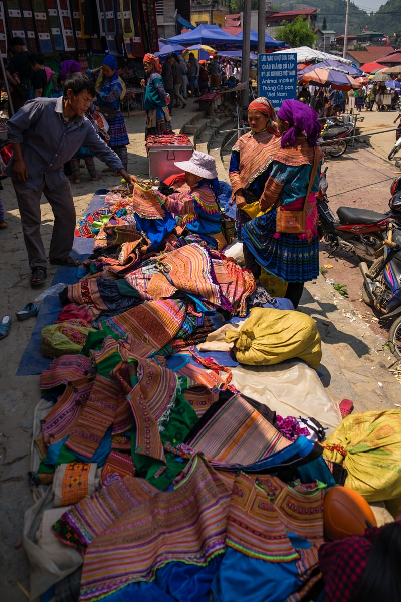 Vietnamese H'Mong women at their clothes stall in Bac Ha Market in Northern Vietnam.
