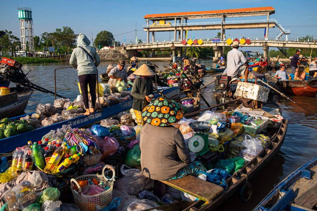 Vietnamese grocery sellers sit on their boats on Phong Dien floating market. Mekong Delta, Can Tho, Vietnam.