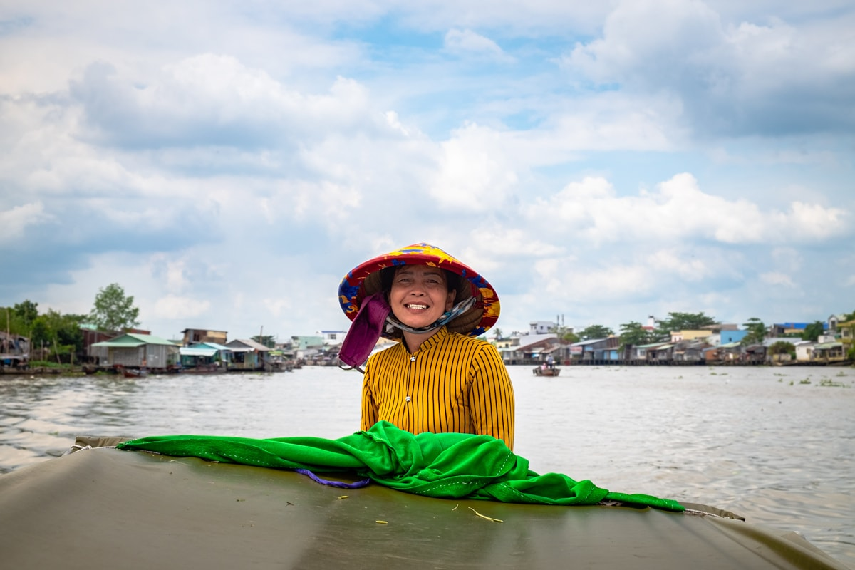 Smiling Vietnamese woman on her boat. Mekong Delta. Can Tho, Vietnam.