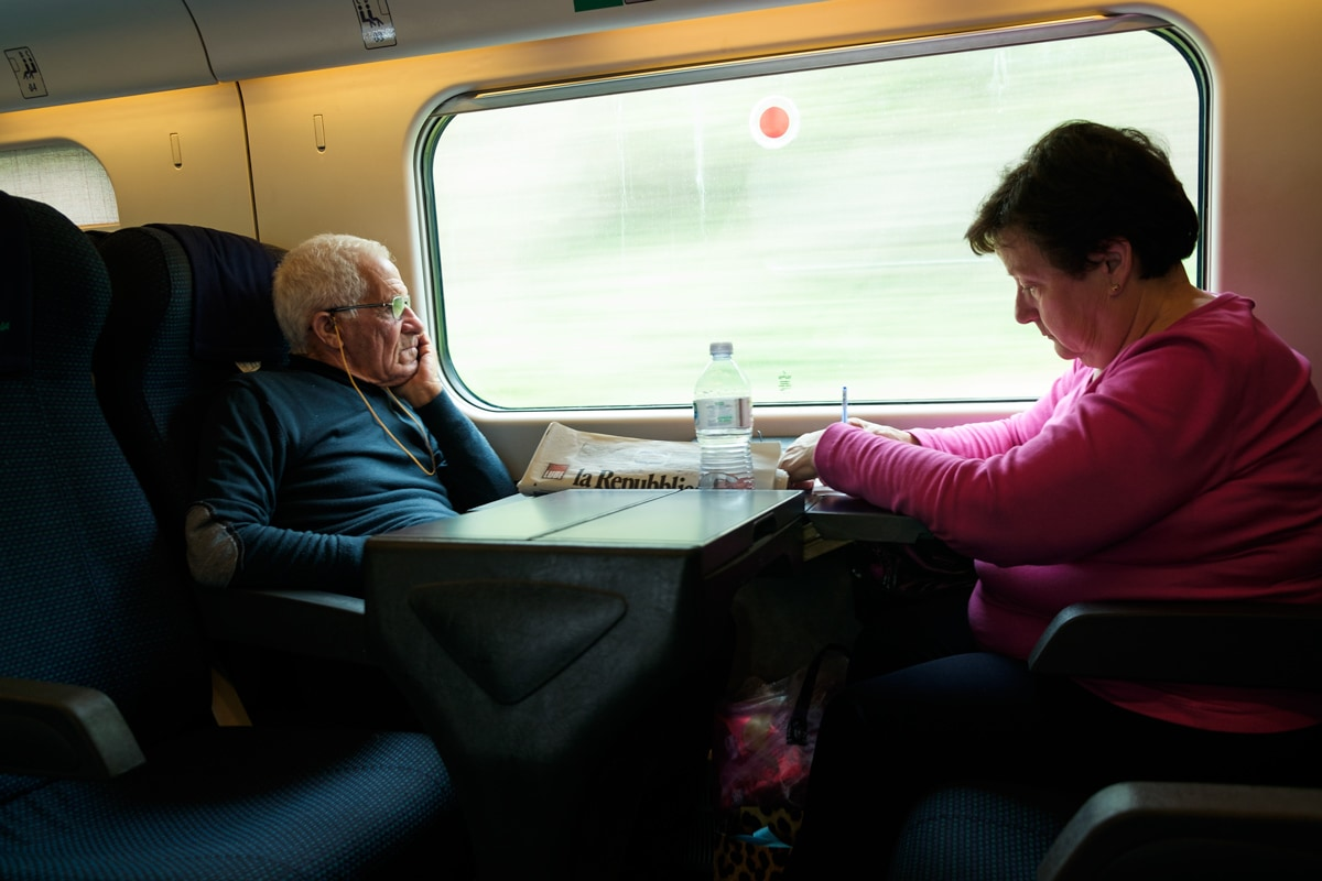 Italian couple on the Rome-Reggio Calabria High Speed Train. Italy.