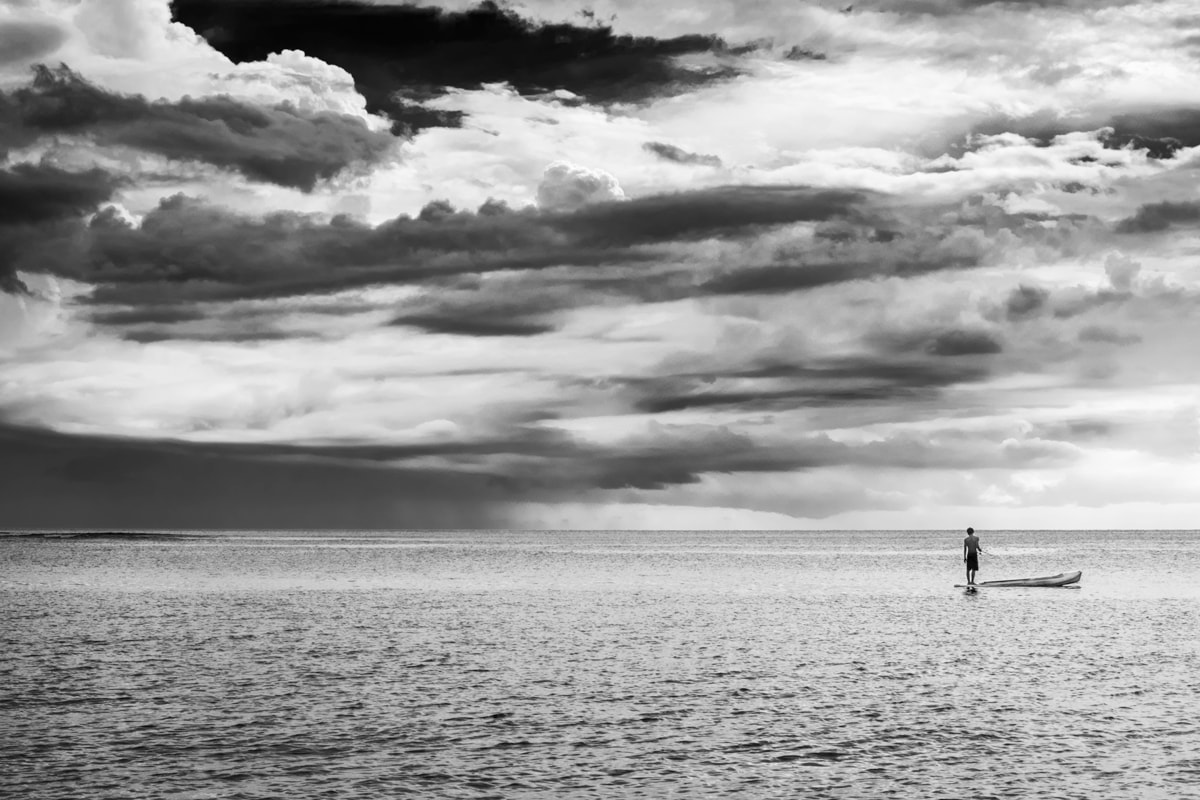 A Black & White image of a fisherman at Senggigi Beach. Lombok Island, Indonesia.