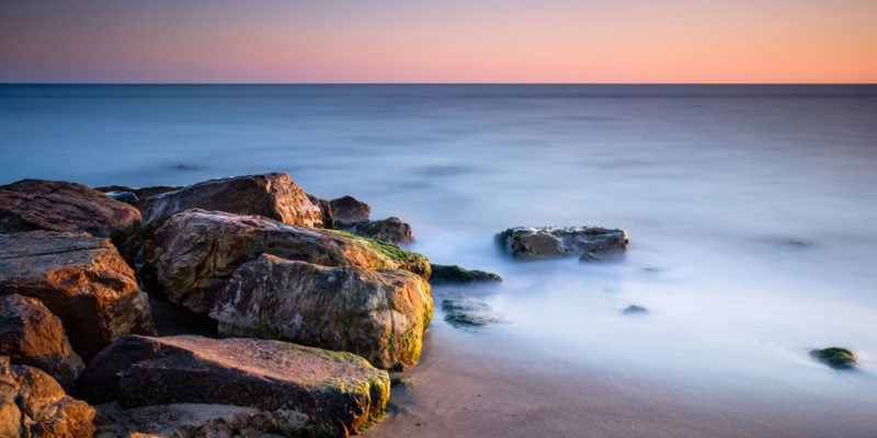Long exposure photograph of rocks at sunset. Why long exposure photography. Long exposure ideas BLOG.