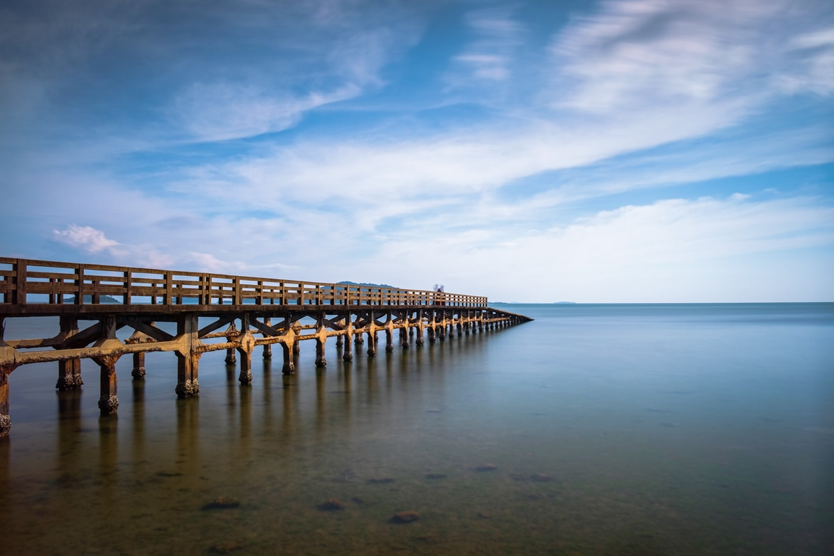 Long exposure photo of the old pier at Kep Beach, Cambodia.