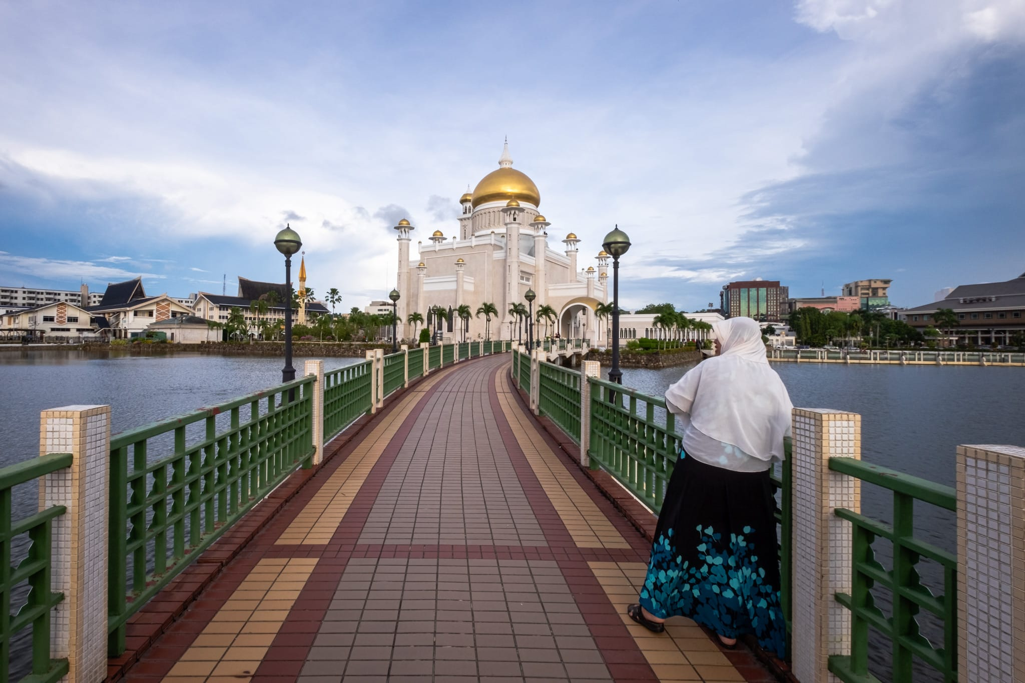 Follower of Islam on the bridge of the Sultan Omar Ali Saifuddien Mosque. Bandar Seri Begawan, Brunei.