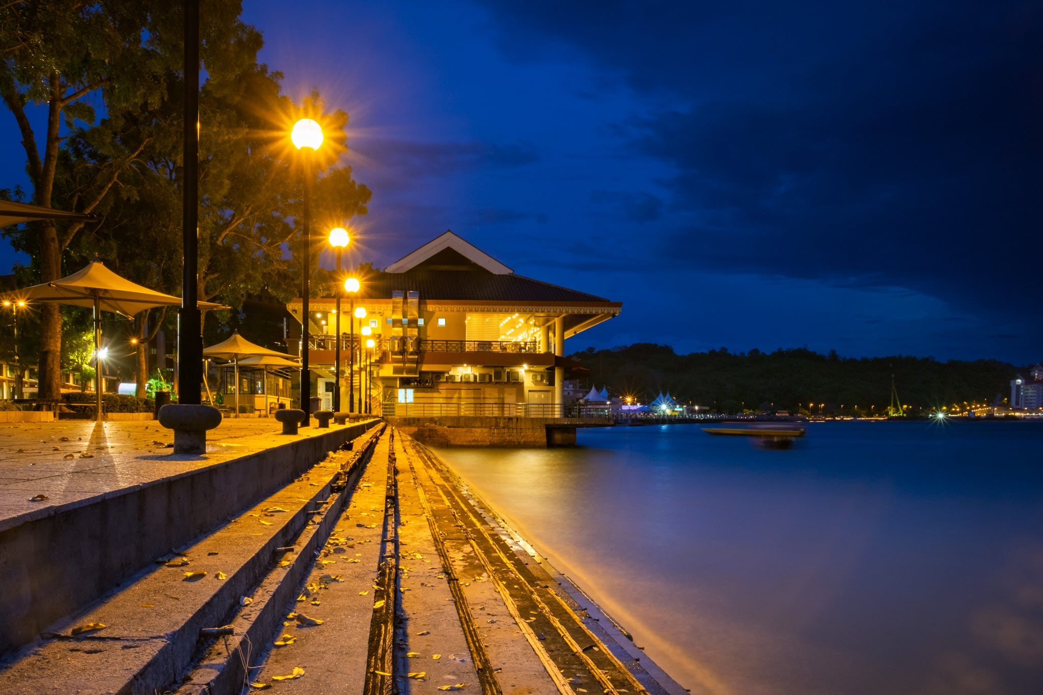 Evening shot of the pier at the waterfront of Bandar Seri Begawan, Brunei. The Horizons Seafood Restaurant is in the background.