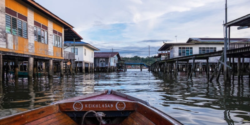 Cruising around Kampong Ayer or the Water Village on the Brunei River in Bandar Seri Begawan, Brunei.