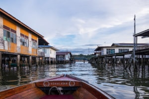 Cruising around Kampong Ayer, or the Water Village on the Brunei River. Bandar Seri Begawan, Brunei.