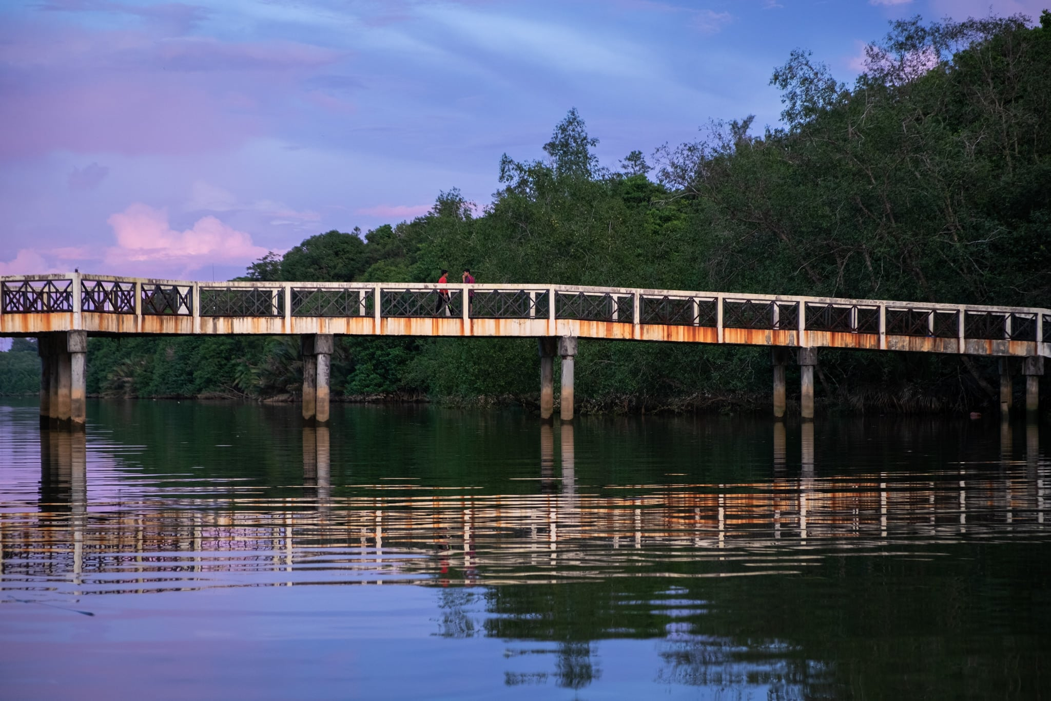 Metal bridge over the Brunei River at Sunset.