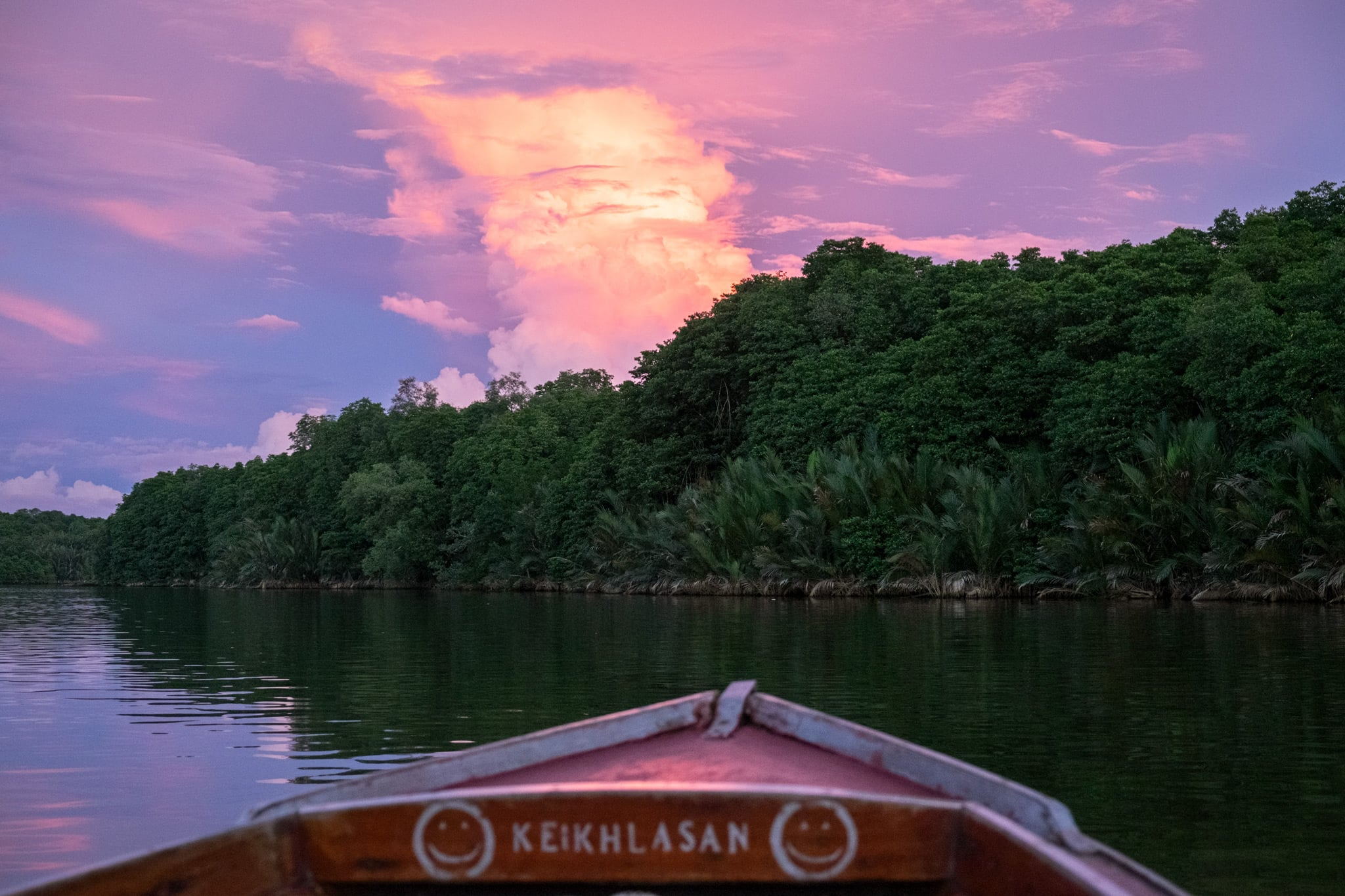 Beautiful sunset over the Brunei River by boat on the way back to the capital Bandar Seri Begawan, Brunei.