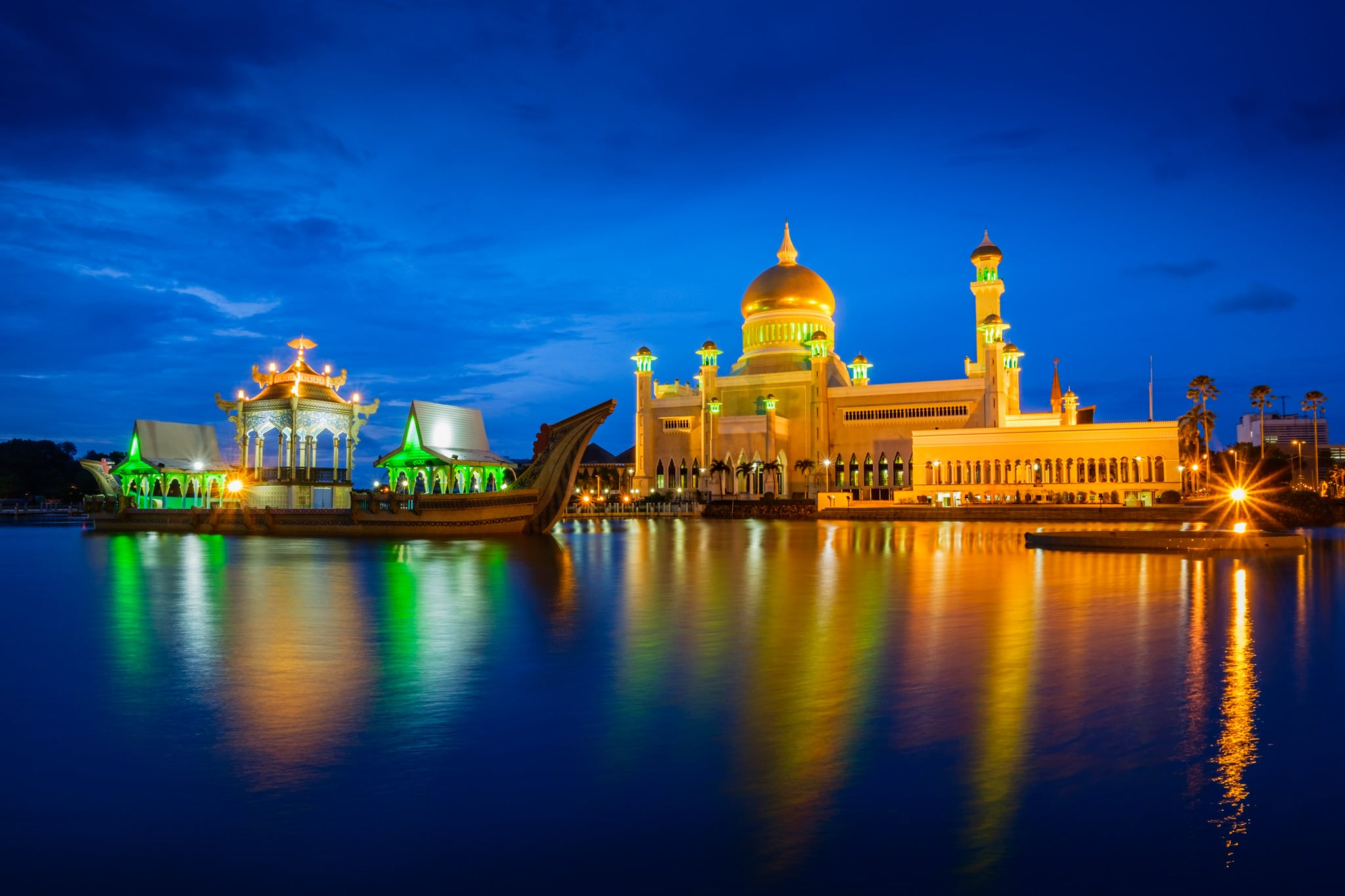 Sultan Omar Ali Saifuddien Mosque in the evening. Bandar Seri Begawan, Brunei. Water of the pond and lights reflection look smooth because of the long exposure.