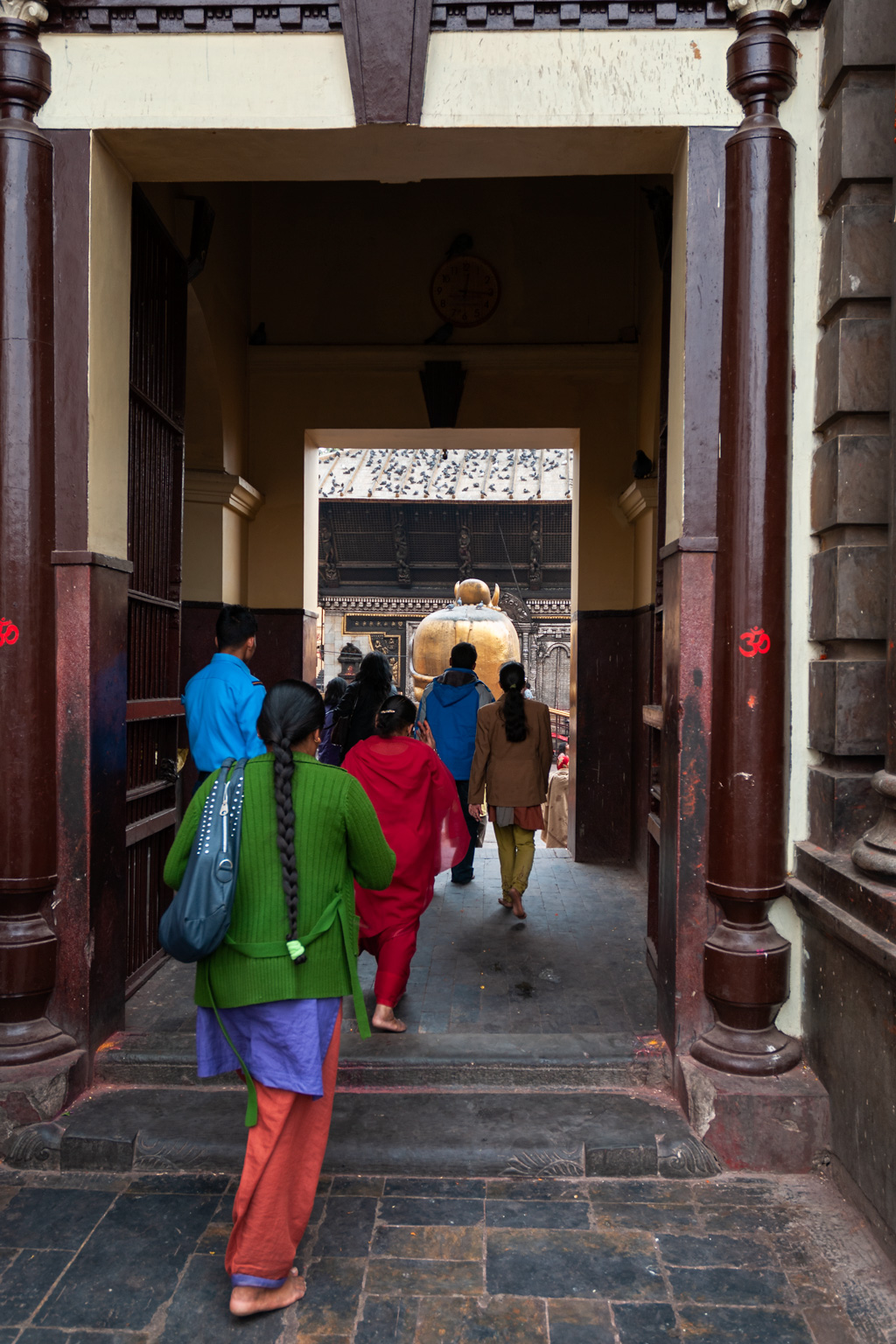 Nepali people enter the Pashupatinath Temple. Kathmandu, Nepal.