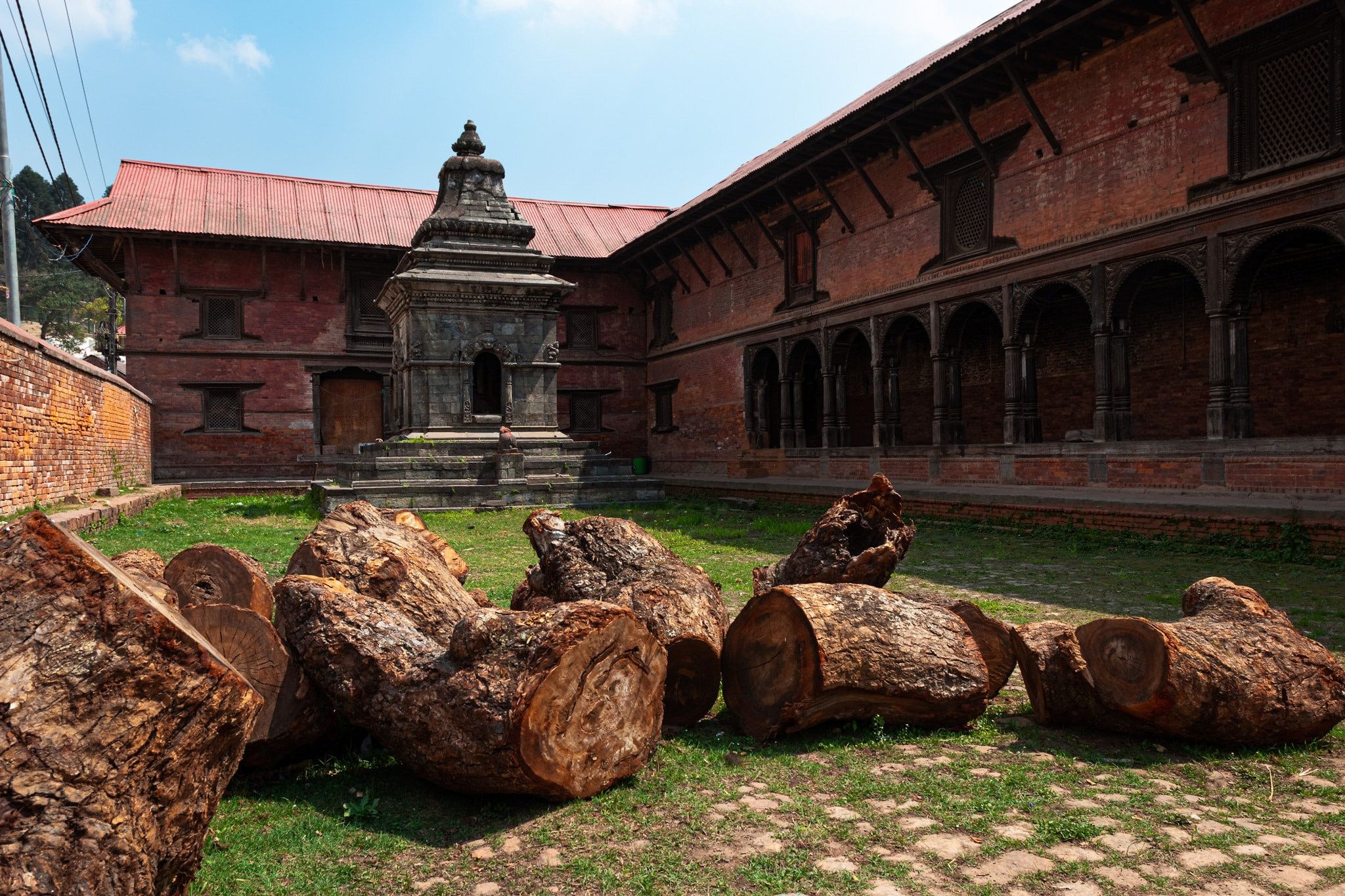Shrine and wood logs at Pashupatinath Temple. Kathmandu, Nepal.