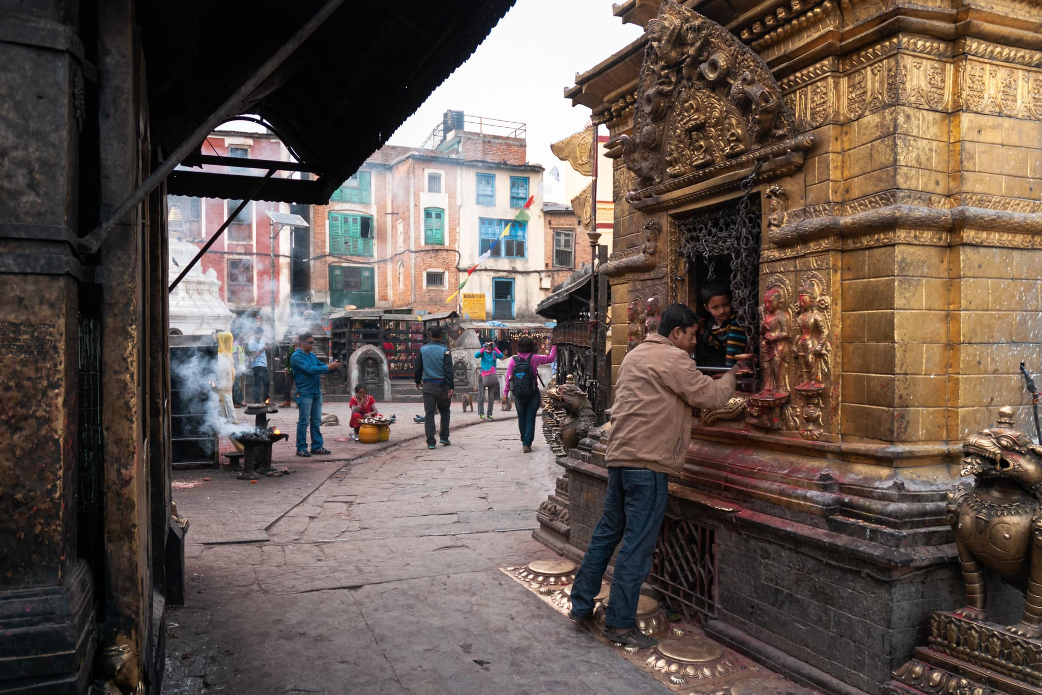 Nepalese child in a shrine at the Swayambhunath (Monkey Temple) complex in Kathmandu, Nepal.