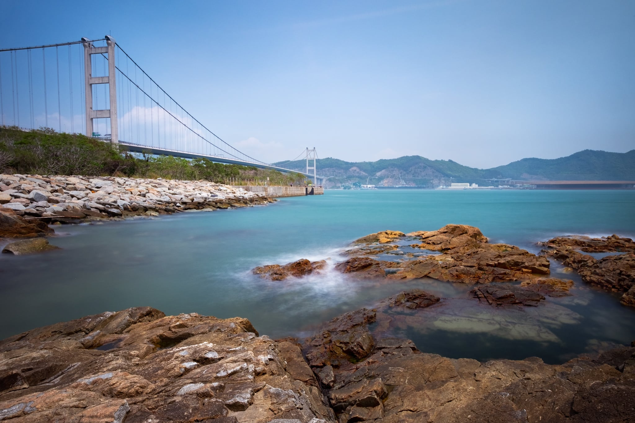 Tsing Ma Bridge. Ma Wan Island, Hong Kong. Sea water looks silky because of long exposure.