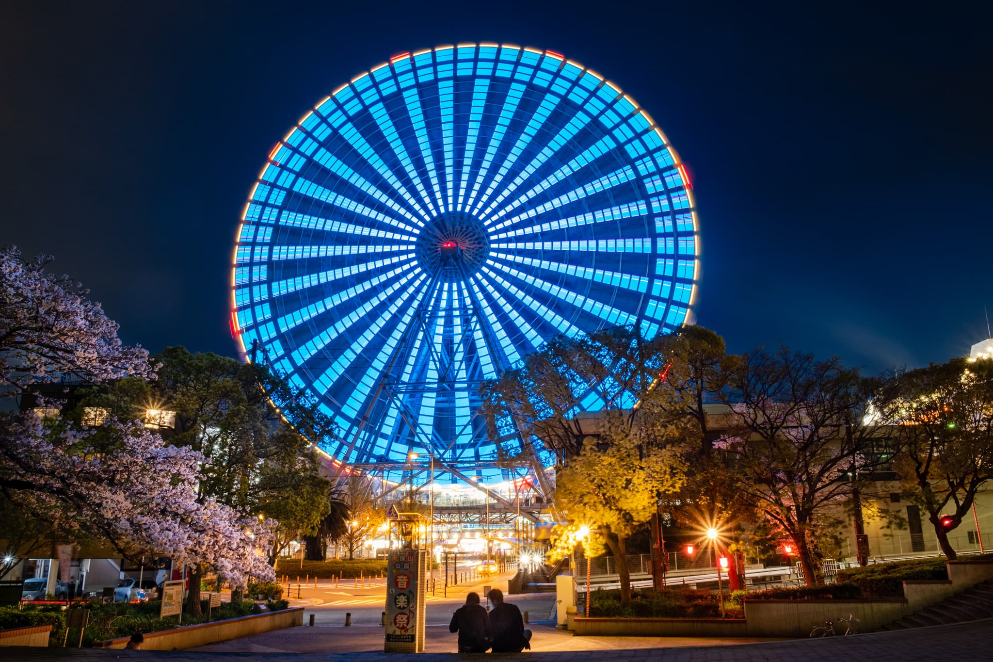 Long exposure of moving Tempozan Ferris Wheel at night. Osaka, Japan.