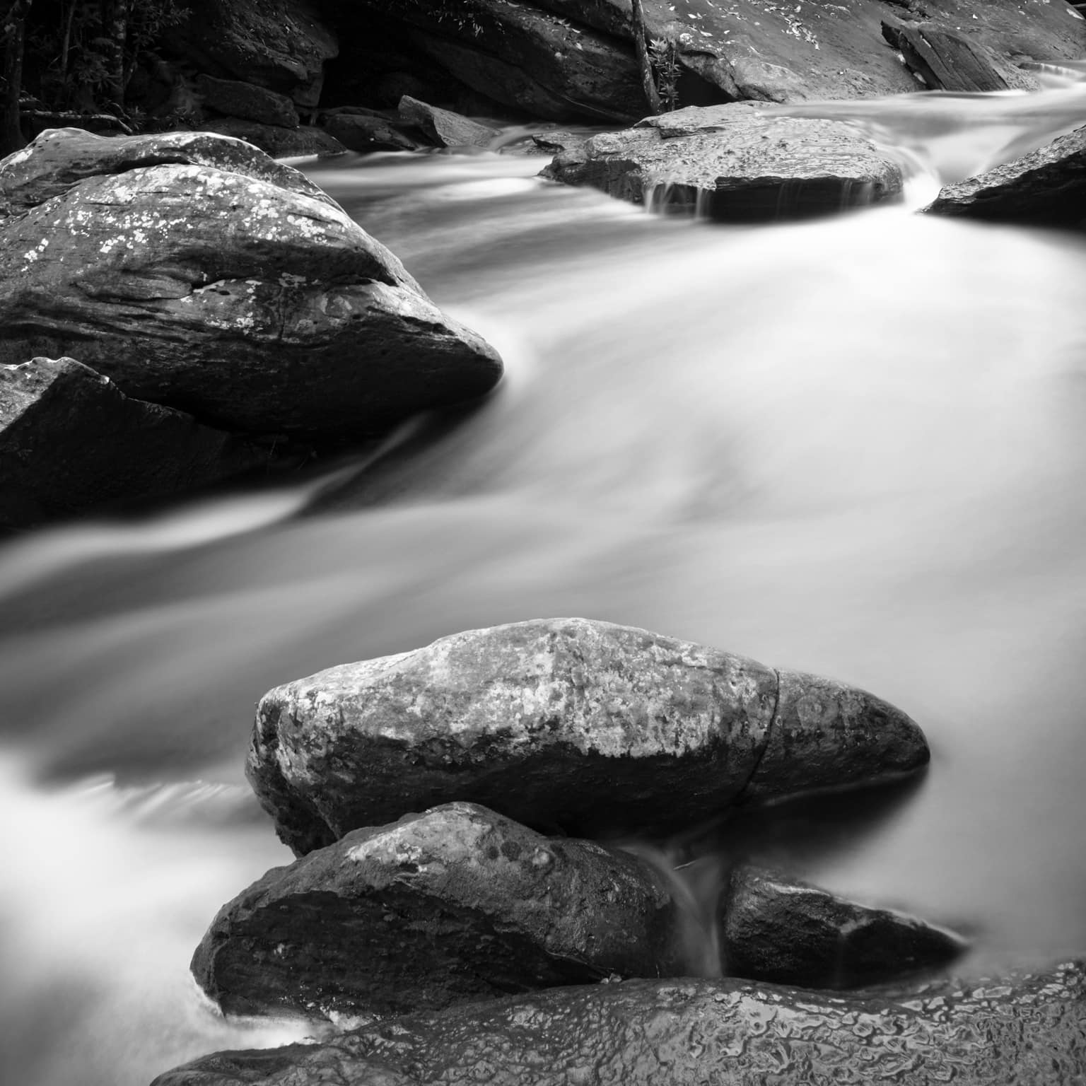 Black and white long exposure of Popokvil Waterfall closeup. Bokor National Park. Kampot, Cambodia. Water looks creamy.