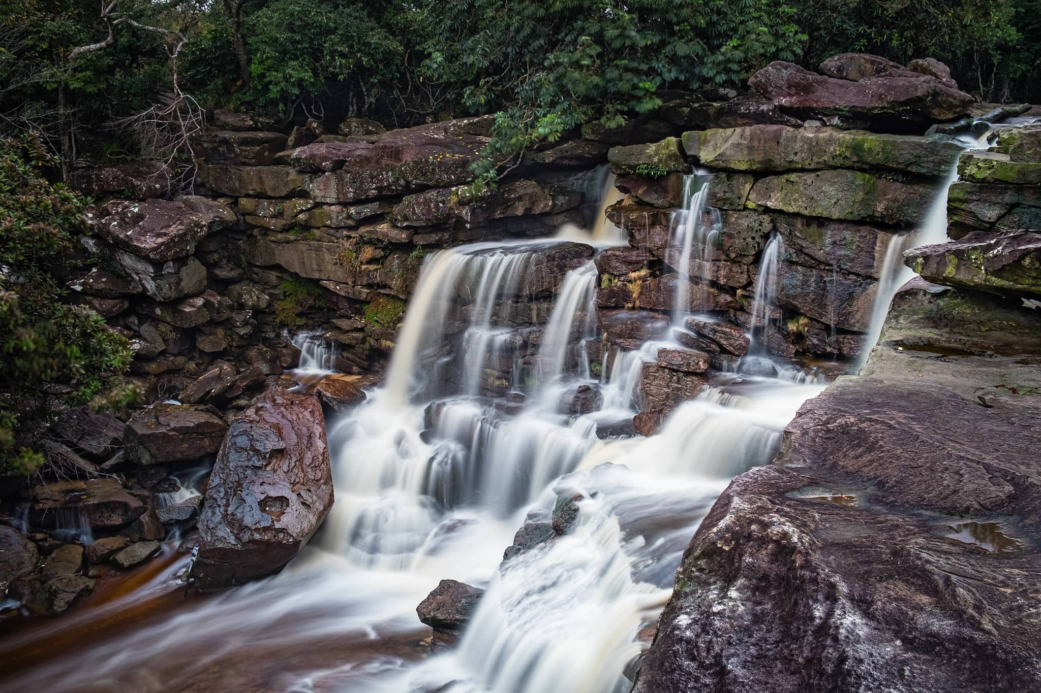 Long exposure of Popokvil Waterfall with smooth and silky water at Bokor National Park. Kampot Cambodia.